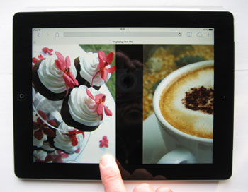 Photo showing web site photo gallery being controlled by swipe gesture on an iPad